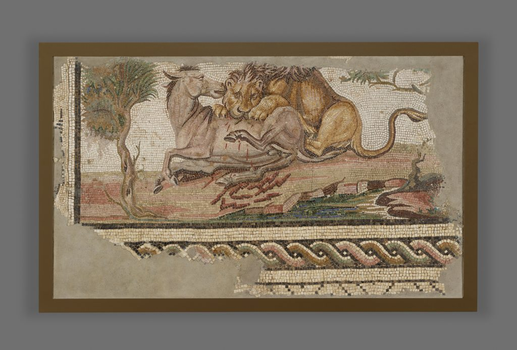 Lion Attacking an Onager. Roman, from Hadrumetum (present-day Sousse, Tunisia), A.D. 150–200. Stone and glass. 38 ¾ x 63 in. The J. Paul Getty Museum, Villa Collection, Malibu, California.