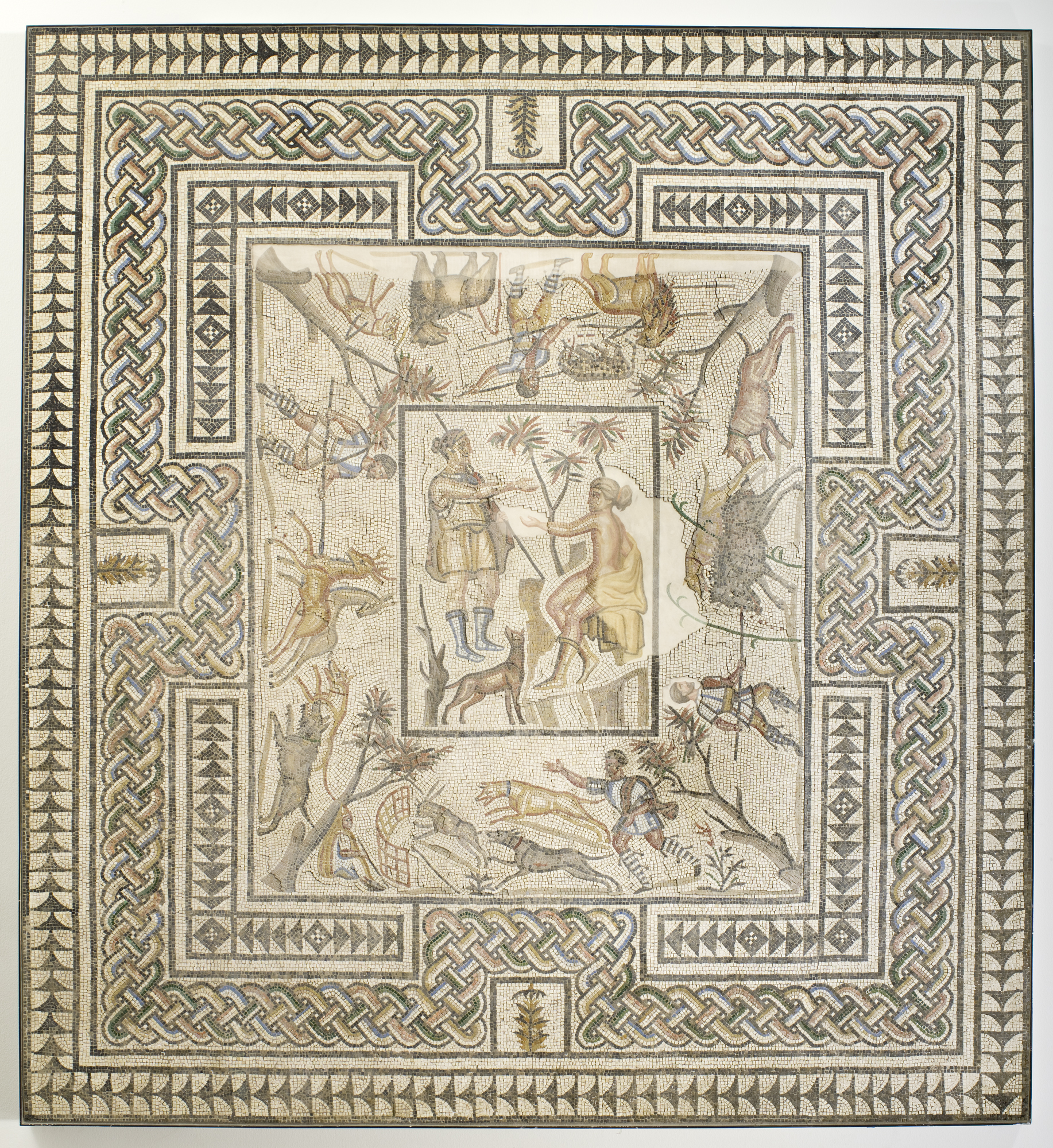 Roman mosaic floor from Villelaure, France with Diana and Callisto Surrounded by Hunt Scenes, A.D. 3rd century. Gallo-Roman mosaic, colored marble, limestone, and glass tesserae. D: 296.6 × 271.8 × 6.4 cm (116 3/4 × 107 × 2 1/2 in.) Los Angeles County Museum of Art, The Phil Berg Collection. Image courtesy of the Los Angeles County Museum of Art, The Phil Berg Collection.