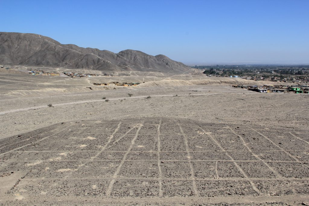 An ancient grid created from the stones in the desert. Image © Caroline Cervera. Nazca lines