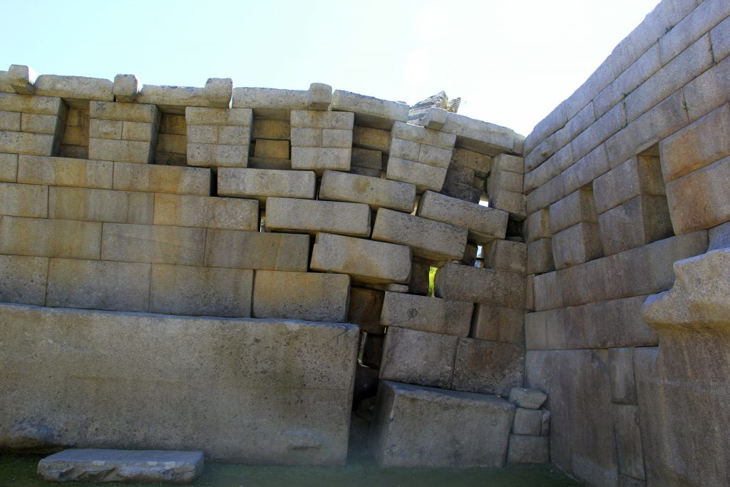 This wall at Machu Picchu has mostly survived despite the obvious seismic activity. It would have been easy for the Incas to rebuild the wall after an earthquake due to this architectural structure. Photo © Caroline Cervera.