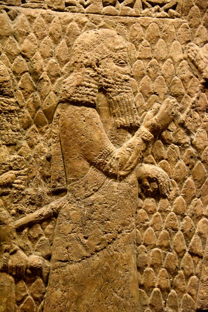 This is one of the most commonly overlooked figures within Lachish's the reliefs. Recognizable by his long sword hanging by his side, his curly beard, and his diadem, this figure greats Sennacherib in a close proximity, almost touching him, denoting a person of a highest rank. This cheif in command of the king and 3nd in command of the whole Assyrian Empire; so-called Turtanu (in Assyrian). From Nineveh (modern-day Mosul Governorate, Iraq), Room XXXVI of the South-West Palace, panels 11-13. The British Museum, London. Photo © Osama S. M. Amin.