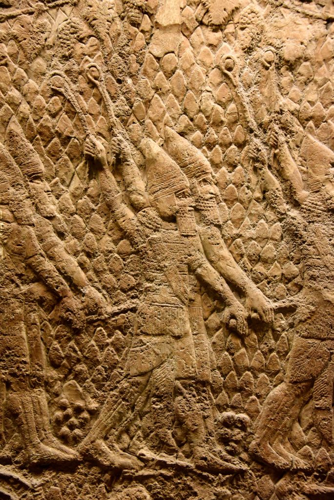 The beginning of the attack on Lachish in 701 BCE. This is a detail of a large stone wall panel which shows that Assyrian solders (part of a large-range artillery, not shown here) are slinging small rounded stones (so-called slingers), aiming at the enemy soldiers, defending the city walls towers. From Nineveh (modern-day Mosul Governorate, Iraq), Room XXXVI of the South-West Palace, panels 5-6. The British Museum, London. Photo © Osama S. M. Amin.