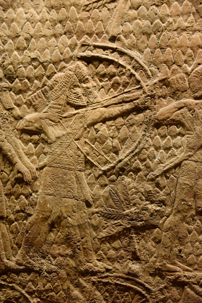 The beginning of the attack on Lachish in 701 BCE. This is a detail of a large stone wall panel which shows that Assyrian archers (part of a large-range artillery, not shown here) are shooting swift arrows with their large bows, aiming at the enemy soldiers, defending the city walls' towers. The archers stand before siege engines (not shown here). From Nineveh (modern-day Mosul Governorate, Iraq), Room XXXVI of the South-West Palace, panels 5-6. The British Museum, London. Photo © Osama S. M. Amin.