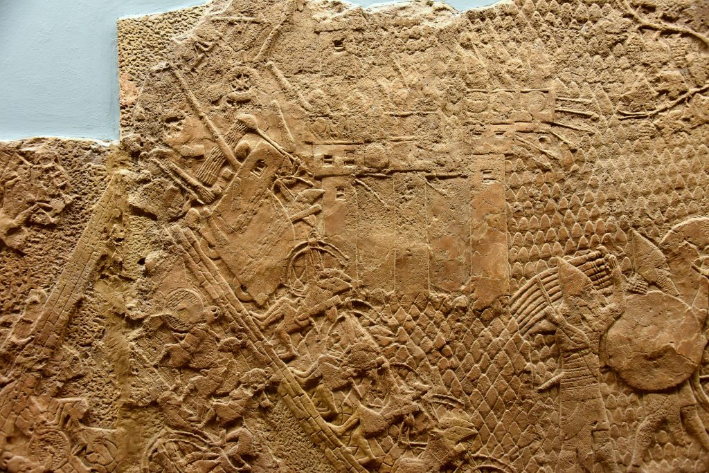 The Assyrian army is crushing the enemy and has reached the city wall. The soldiers of Lachish are still within their protective towers. From Nineveh (modern-day Mosul Governorate, Iraq), Room XXXVI of the South-West Palace, panel 7. The British Museum, London. Photo © Osama S. M. Amin.