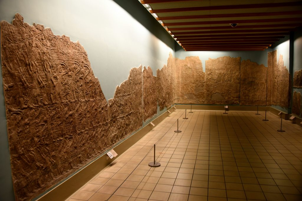 Room 10b at the British Museum. The Siege of Lachish wall reliefs can be seen here with their corresponding description. Photo © Osama S. M. Amin.